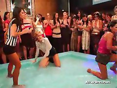 Sexy girls oil wrestling clothed