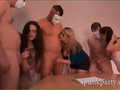 Masked men enjoy getting their cocks stroked by horny babes