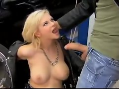 Euro slut in a leather jacket sucks a dick