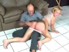 Naughty blonde getting spanked by older man