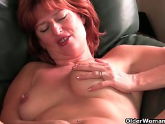 Redheaded experienced mama plays with her nipples and cunt