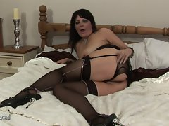 Filthy attractive mature slutty mom playing with her rubber toy