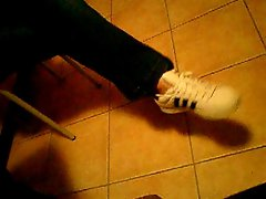 Sneakers young woman Dangling shoes adidas superstars