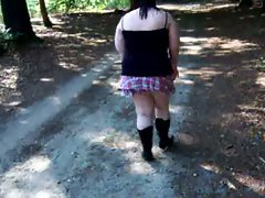 Thick in short skirt in the woods