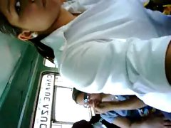 young lady touching phallus in bus