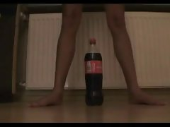 Teensy sassy teen tries to ride a coke bottle
