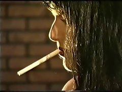 Leather Gloved Dark haired Dominatrix Smoking Torture Up-Close