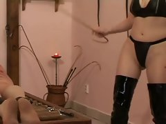 mistress uses her slave and a cane