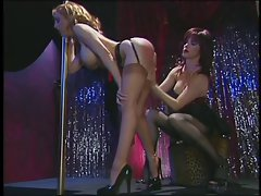 Dark haired hussy spanks the blond babe's butt
