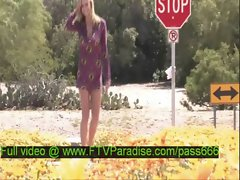 Lisa tender sexy blonde babe walks among flowers