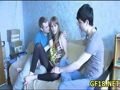 Sweet-looking teen gal takes hard cock of stranger in her tender hand