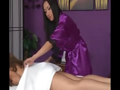 Sexy dyke giving massage to naked lady