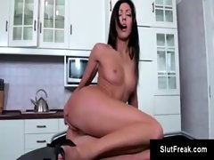 Raven-haired beauty heats things up in the kitchen