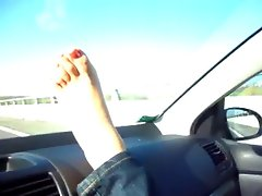 delicios feet in car trip