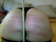 wife2 after caning in bedroom with red marks