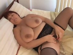Beatiful busty milf in stockings works her fat juicy pussy demilf