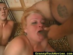 Chubby granny fucked hard by two guys