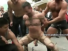 Procession of gay men take their sex slave spanking him in public group sex video