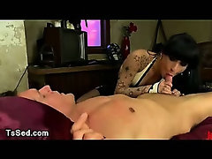 Chained guy in bed sucked by tranny in hotel room