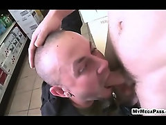 Guy giving his friend a blowjob inside the liquor store