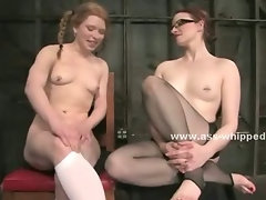 Bitch with glasses and tight old dress spanks and plays with lesbian babe tied with hands behind
