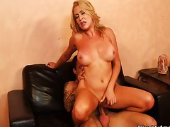 Busty MILF invites sons friend to tit fuck