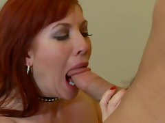 Redhead mommy Brittany Oconnell shows her lack of a gag reflex on this cock