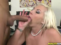 Sizzling blonde boss Skyler Price munches a massive cock with pleasure
