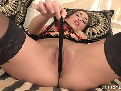 Busty Mya Diamond in sexy black lingerie fingers her dripping pussy