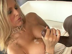Julia Ann gets a load of cum shot onto her tits