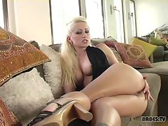 Jessica Darling uses her fingers to play with her hard clit on the couch