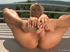 Vega Vixen caressing her hot pussy with her soft heels