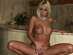 hot blonde Adelle plays inside with big tits