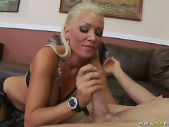 Hot blonde Sue Diamond in stockings and lingerie blowing pole