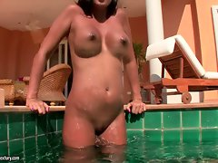 Sash Cane spreads her tanned legs and fondles herself