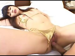 Busty Asian girl slurps on his rod and then gets drilled hard