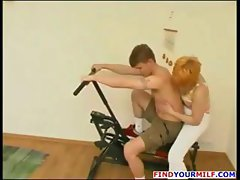Redheaded Russian MILF Kristina gets a young cock to bang