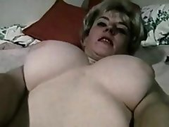 Busty blonde is alone and going solo rubbing her hairy pussy