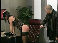 Office babe submits to a spanking and gets her ass whacked hard