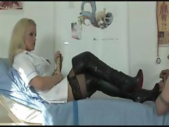 Blonde mistress gives her slave a lesson in humility and foot worship