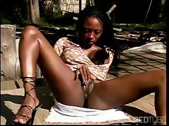 Hot ebony babe is outside and horny and rubs her shaved twat