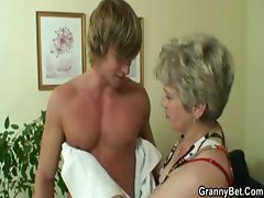 Old blonde granny gets a young man to bang her after giving head