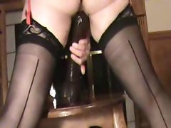 Lady in lingerie and stockings is toying her pussy on camera