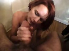 Brunette does striptease, smokes, and then smokes his cock in POV