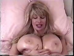 Dishonest chicken head with a genial mound teases and plays with her boobs