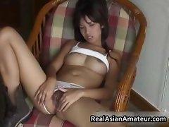 Little asian amateur plugs a huge dildo