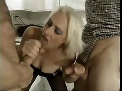 Horny blonde granny takes on two young studs and gets and with a DP