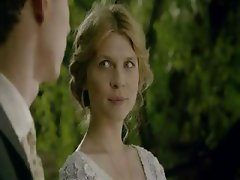 Blonde actress Clemence Poesy in scenes from one of her movies