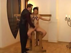 Brunette gets tied up and tortured and played with in BDSM clip