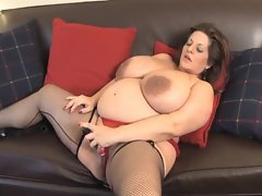 Fat mature in stockings fucks cunt with toy